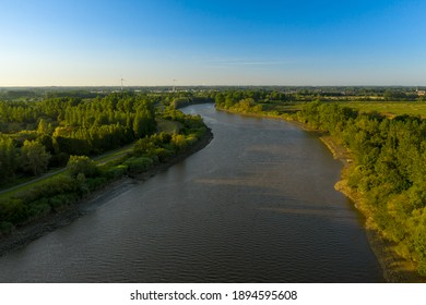 Aerial view of the Scheldt river, at sunset, in Baasrode, East Flanders, Belgium