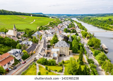 Aerial view of Schengen town center over River Moselle, Luxembourg, the place where Schengen Agreement signed, the birthplace of a Europe without borders. Tripoint of borders with Germany and France.