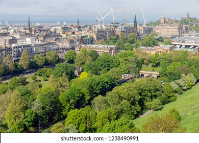 Aerial view from Scottish Edinburgh castle at Princes Street gardens and Waverley railway station. In the background Calton Hill