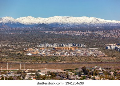 Aerial view from Scottsdale looking north at a rare dusting of snow in Cave Creek, Arizona of the desert foothills