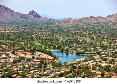 Aerial view from Scottsdale to Phoenix, Arizona above golf course and upscale homes