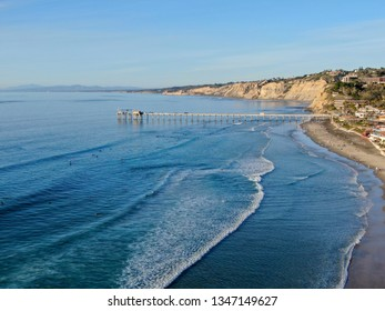 Aerial view of the scripps pier institute of oceanography, La Jolla, San Diego, California, USA. Research pier used to study ocean conditions and marine biology.  Pier with luxury villa on the coast.