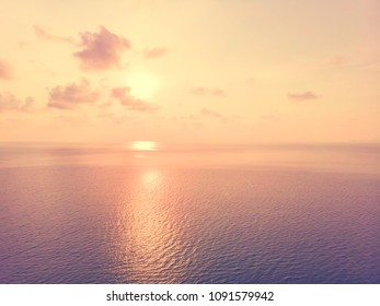 Aerial view of sea and beach with coconut palm tree on island at sunset time