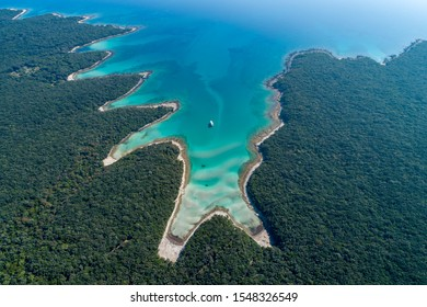 Aerial view of sea and beach in a lagoon on Cres ( isola Cherso )  Island Croatia, close to Punta Kriza; Punta Croce. It is a part of national where rocks and sand and forest merge on a coast.