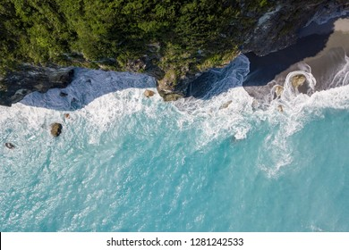 Aerial view of Sea cliff with wave turbulence ,crystal clear sea water  At Taroko national park , Hualien ,Taiwan