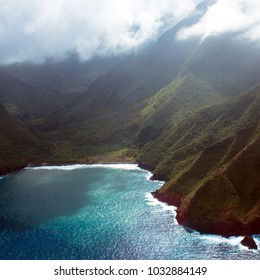 Aerial view of sea cliffs, Pacific surf, and fog on the coast of the island of Molokai in Hawaii