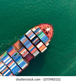 Aerial view of sea freight, Cargo ship, Cargo container in factory harbor at industrial estate for import export around in the world, Trade Port / Shipping - cargo to harbor - Shutterstock ID 1075983152