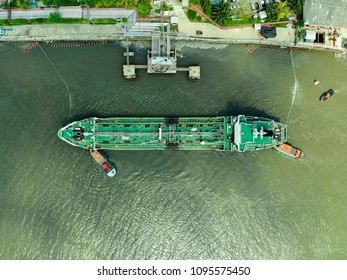 Aerial view of sea freight, Crude oil tanker lpg ngv at industrial estate Thailand / Crude Oil tanker to Port of Singapore - import export around in the world