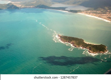 aerial view of sea and rocks on beach in Santa Catarina State, south of Brazil