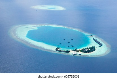 Aerial view from a seaplane of the Maldives atolls.