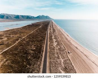 Aerial view from seashore together saltworks. Cabo de Gata, Nijar, Salinas. Almeria.