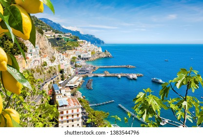 Aerial view of seaside city Amalfi in province of Salerno, Campania, Italy. Amalfi coast on Gulf of Salerno is popular travel and holyday destination in Italy. Ripe yellow lemons in foreground.