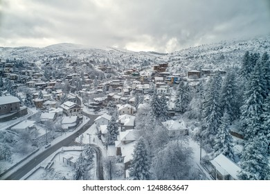 Aerial View of Seli Traditional Greek Village Covered by Snow in Winter Morning. Top Tourist Destination in Northern Greece