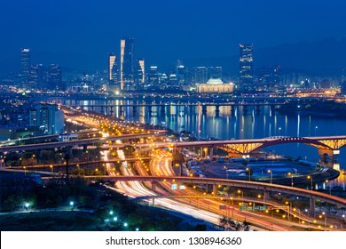 Aerial view of Seoul downtown cityscape and Seongsan bridge over Han River in twilight. Seoul, South Korea.