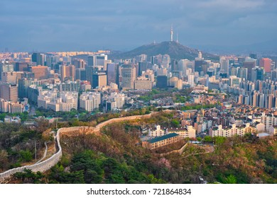 Aerial view of Seoul downtown cityscape and Namsan Seoul Tower on sunset from Inwang mountain. Seoul, South Korea.