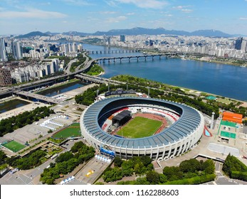 Aerial view Seoul Olympic Park, South Korea. The stadiums are built for the 1988 Summer Olympics and the 10th Asian Games in 1986. Olympic & baseball stadium with city. Seoul, South Korea 08/20/2018