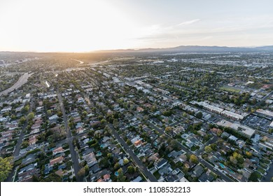 Aerial view of setting sun over Van Nuys in the San Fernando Valley in Los Angeles California.