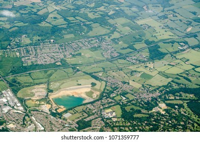 Aerial view of Sevenoaks in Kent with the Tarmac  quarry which provides sand for mortar in construction.  The M26 motorway runs across the middle of the image with the village of Kemsing to the north.