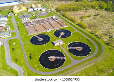 Aerial view of sewage treatment plant. Industrial water treatment for big city from drone view.