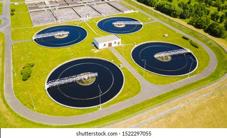 Aerial view of sewage treatment plant. Industrial water treatment for big city from drone view. Waste water management. Background concept.