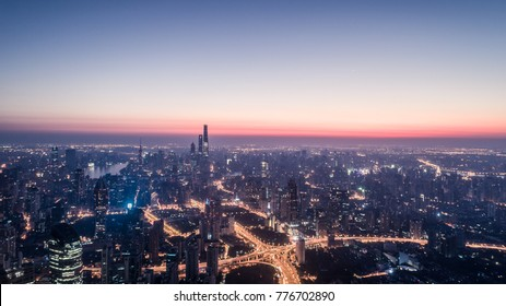 Aerial View of Shanghai city in the dawn with cloudy sky