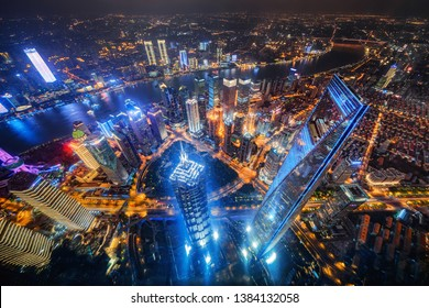 Aerial view of Shanghai Downtown, China. Financial district and business centers in smart city in Asia. Top view of skyscraper and high-rise buildings at night.