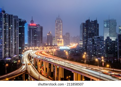 Aerial view of Shanghai viaduct night, severe traffic congestion