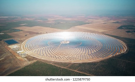 Aerial view of shining tower at modern solar power station