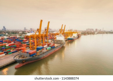 Aerial view of ship containers at shipping port for international import or export logistics or transportation business concept background.