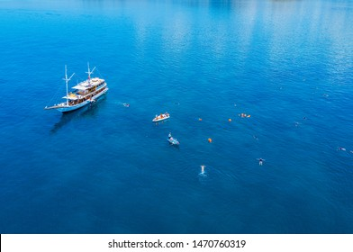 Aerial view of a ship and tourist snorkeling at Flores Island