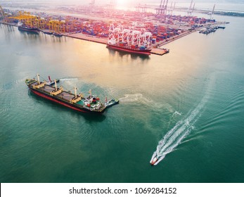aerial view of ships vessels operation in port for loading discharging the cargo shipments with arrival and departure in an international port services