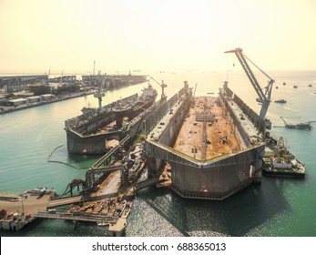 aerial view shipyard have crane machine and container ship in green sea