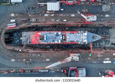 Aerial view of a shipyard repairing a large ship