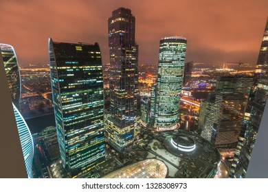 Aerial view of shopping and entertainment complex business complex Moscow City at night. Evening lights of Moscow International Business Center