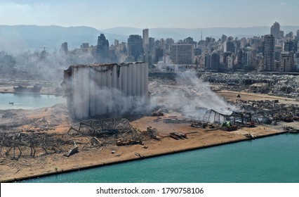 An aerial view shows the massive damage done to Beirut port's grain silos (C) and the area around it on August 5, 2020, one day after a mega-blast tore through the harbour in the heart of the Lebanese