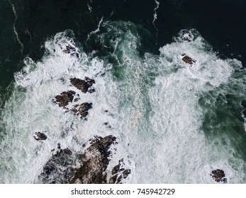 An aerial view shows swells from the Pacific Ocean washing against the coast of the Monterey peninsula in California. This scenic area, just south of San Francisco, is a popular tourist destination.