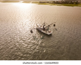 Aerial view of shrimp boat off the coast of South Carolina at sunrise,