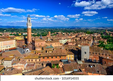 Aerial view of Siena with Campo Square (Piazza del Campo), Palazzo Pubblico and Mangia Tower (Torre del Mangia) in Siena, Tuscany, Italy. Architecture and landmark of Siena.