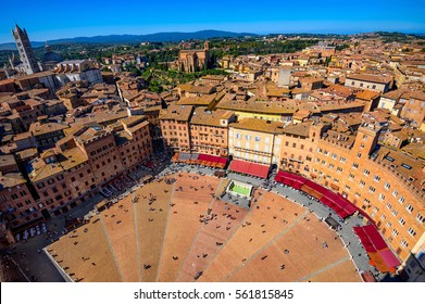Aerial view of Siena, Campo Square (Piazza del Campo) and Siena Duomo in Siena, Tuscany, Italy.