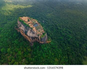 Aerial view of Sigiriya rock at misty morning, Sri Lanka. Drone footage.