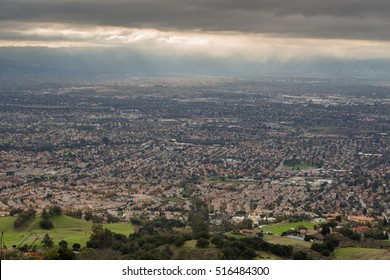 Aerial View of the Silicon Valley, Green Countryside, and Ominous Sky. San Jose and Southern Silicon Valley as seen from Mount Hamilton in the Fall of 2016.