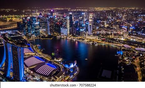 Aerial view Singapore City skyline at night, Marina bay, Singapore.
