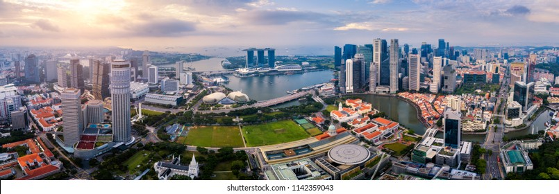 Aerial view of the Singapore landmark financial business district at sunrise scene with skyscraper and over clouds. Panorama of Singapore downtown.