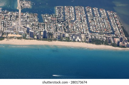 Aerial view of the Singer Island community with the Ocean Mall, beach access and hotels and condos on the beach