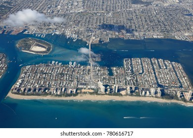 Aerial view of Singer Island, Florida, with Peanut Island, and the Blue Heron Bridge connecting with the mainland.