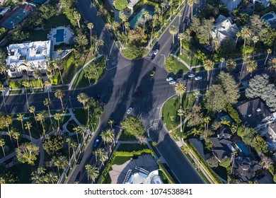 Aerial view of six way intersection at N Beverly Drive and N Canon Drive and Lomitas Ave in Beverly Hills, California.