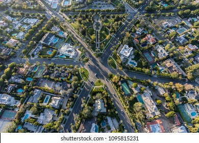 Aerial view of six way intersection at N Beverly Drive and N Canon Drive and Lomitas Ave in beautiful Beverly Hills, California.