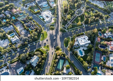 Aerial view of six way intersection at N Beverly Drive, N Canon Drive and Lomitas Ave in Beverly Hills, California.