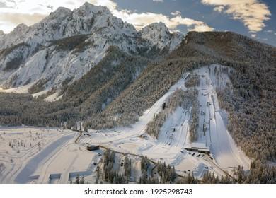 Aerial view of Ski Jump in Planica, Slovenia at Ratece near Kranjska gora in winter with snow. - Shutterstock ID 1925298743