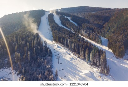 aerial view of a skii resort in the carpathian mountains on a sunny day